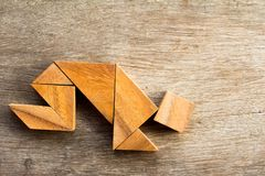 Free Wooden Tangram Puzzel In Man Crouch Shape Royalty Free Stock Photo - 108881065