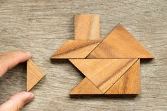 Wooden tangram puzzle in home shape wait for completion Concept. For family building or dream life royalty free stock images