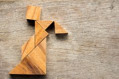 Free Wooden Tangram Puzzle In Woman Held The Lattern Shape Stock Photos - 106770733