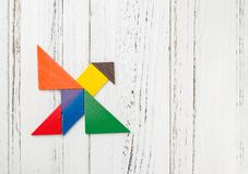 Wooden tangram shaped like a flying bird. With copy space Stock Photo