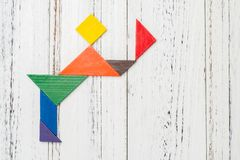 Wooden tangram shaped like a people bowing and  taking off his hat Royalty Free Stock Photography