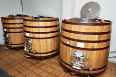 Wooden tank barrels for aging wine at winery Royalty Free Stock Photo