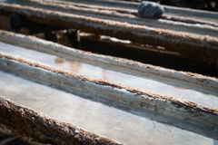Wooden tanks for sea salt production in Bali, Indonesia Stock Images