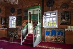 Wooden Tatar mosque interior in Bohoniki, Poland. BOHONIKI, POLAND -  MAY 03, 2018: Wooden tatar-mosque interior from the 18th century. The decorations and Royalty Free Stock Photo