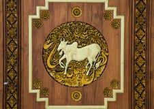 Wooden taurus zodiac symbol. Carve stock photos