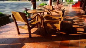 Wooden tea table under sun shine Royalty Free Stock Photo