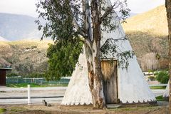 Wooden Teepee near reservation royalty free stock photography