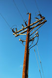 Wooden telegraph pole Stock Image