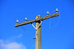 Wooden telegraph pole Stock Images