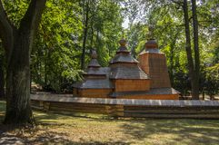 Wooden temple Church of St. Nicholas originally from Slovak village Habura in Hradec Kralove gardens, old historic building during. Summer stock images