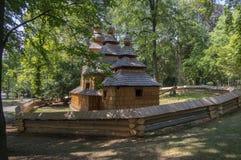 Wooden temple Church of St. Nicholas originally from Slovak village Habura in Hradec Kralove gardens, old historic building during. Summer stock image