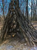 Wooden tepee in nature center. Tepee made from wooden branches in children`s play area at nature center Royalty Free Stock Photography