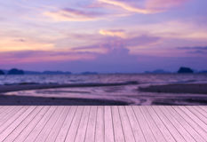 Wooden terrace against sunset beach blurred background Royalty Free Stock Photography