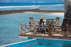 Wooden terrace on the beach Stock Images