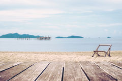 Wooden terrace and the beach view with chair stand alone in summer Royalty Free Stock Photography
