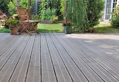 Wooden terrace in garden. Wooden terrace in a garden royalty free stock photography