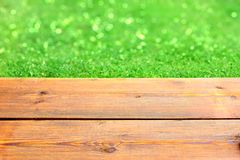 Wooden Terrace and Green Bokeh Royalty Free Stock Image