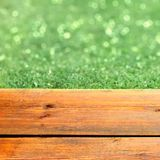 Wooden Terrace and Green Bokeh Stock Photography