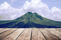 Wooden terrace with landscape of mountain and sky, vintage tone Royalty Free Stock Photos