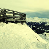 Wooden terrace at mountain ski resort in Alps, Austria Royalty Free Stock Image