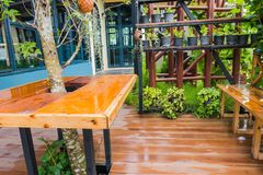 Wooden terrace Outside the house In the rainy season.  Royalty Free Stock Images
