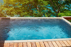 Wooden terrace with pool Royalty Free Stock Image