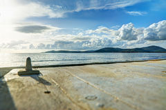 Wooden terrace by the shore in Sardinia Stock Image