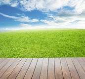 Wooden terrace with views of nature green grass field Royalty Free Stock Photography