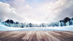 Wooden terrace in winter mountain landscape at snowfall Stock Photo