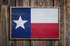 Wooden Texas flag. 3d rendering of a Texas State USA flag on a wooden frame and a wood wall Royalty Free Stock Image