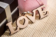 Wooden text love with gift box. Valentines concept Royalty Free Stock Images