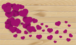 Wooden texture background with pink hearts Royalty Free Stock Images