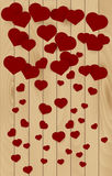 Wooden texture background with red hearts. Falling effect Stock Images