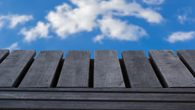 Wooden texture on blue sky Royalty Free Stock Photo