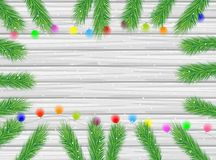 Wooden texture with the branches of christmas tree and bright ga Stock Photography