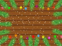 Wooden texture with the branches of christmas tree and bright ga Stock Images