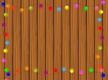 Wooden texture with bright garlands Royalty Free Stock Images