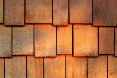 Wooden texture of cedar shingles. Abstract wooden texture of red cedar shingles, shake wood siding row roof panel Royalty Free Stock Images