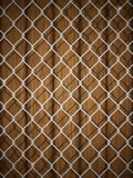 Wooden texture with chain fence. Royalty Free Stock Photo