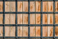 Wooden texture framed by metal. Forged strips. Stylization of the ancient gate of the castle Stock Photo