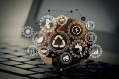 wooden texture globe with social media diagram on laptop compute Stock Images