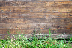 Wooden texture and grass. Wall of wooden houses and grass Stock Photo