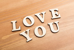 Wooden texture letters forming with phrase Love You Stock Images