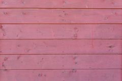 A wooden texture made of lightly burgundy stock image