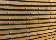 Wooden texture metal rivets - fragment historical ship drawing. Old boards Royalty Free Stock Photos