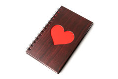 Wooden texture notebook with red heart on white background Stock Photography