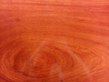 Red wooden texture with oil - some reflexes on the wood royalty free stock photography