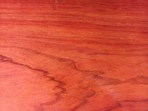 Red wooden texture with oil - some reflexes on the wood royalty free stock photo