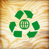 Wooden texture with recycle symbol Royalty Free Stock Photos