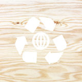 Wooden texture with recycle symbol Stock Photos